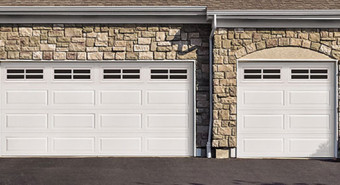 The Classic Steel Garage Door Model 8300 has an impressive R-value* of 12.12 using polyurethane foamed-in-place. The Classic Steel Garage Door Model 8500 is Wayne Dalton's highest insulated residental garage door with an impressive R-value of 16.22 using polyurethane foamed-in-place.  Heavy-gauge steel wrap around end caps trim-out door edges for better appearance, improved strength and damage-protection of the insulation. Plus its two-coat, baked-on polyester finish makes it virtually maintenance free.