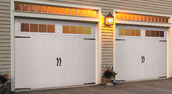 "Our Classic Steel Garage Door Model 9100 and 9600 feature pinch resistant door panels. Chosen by homeowners for its strength, durability, and gracious design, this steel garage door models have polyurethane foamed-in-place insulation. The steel garage door Model 9100 is constructed with a steel-polyurethane ""Toughguard"" backer and has an R-value* of 9, and the Model 9600 door  has an R-value of 11, giving both of these garage doors excellent insulating ability to your home's thermal efficiency."